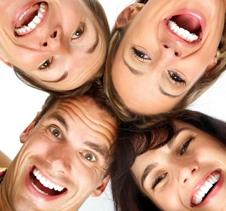 People smiling at the camera for Teeth Whitening at Logan Smiles